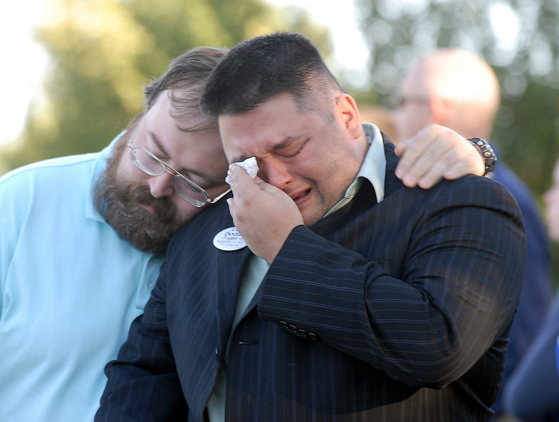 BE0919NINE01<br /> Joshua Miller cries in memory of his friend Deora Bodley, who died on Flight 93, is comforted by his friend David Henderson during the ceremony at the 9/11 Memorial on Saturday.<br /> <br /> September 11, 2010<br /> staff photo/David R. Jennings