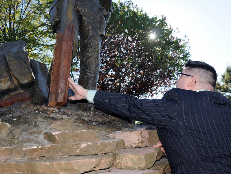 BE0919NINE27<br /> Joshua Miller reaches to touch the section of steel from the World Trade Center in on of the sculptures at the 9/11 Memorial after the ceremony on Saturday.<br /> <br /> September 11, 2010<br /> staff photo/David R. Jennings