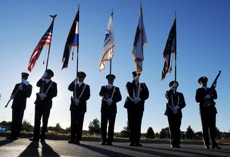 BE0919NINE09<br /> The combined Broomfield Police and North Metro Honor Guard stand at attention during the ceremony at the 9/11 Memorial on Saturday.<br /> <br /> September 11, 2010<br /> staff photo/David R. Jennings