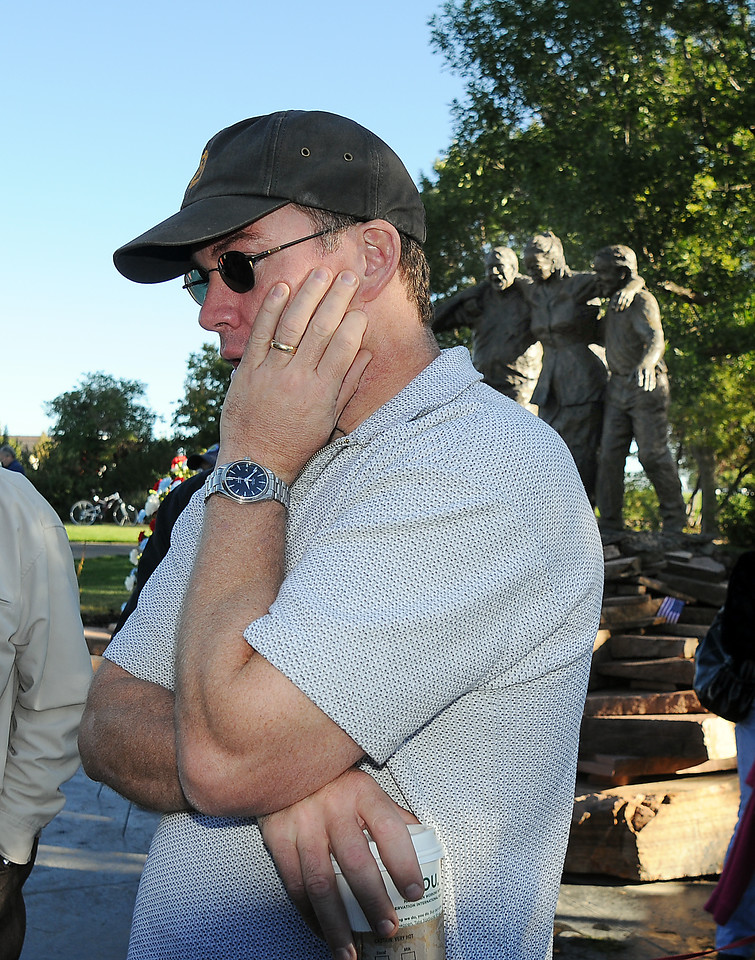 BE0919NINE10<br /> Michael Faughnan  takes a moment on Saturday during the 9/11 ceremony at the 9/11 Memorial to remember his brother Chris who died in the World Trade Center attack .<br /> <br /> September 11, 2010<br /> staff photo/David R. Jennings