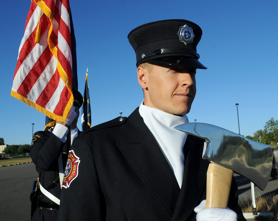 BE0919NINE15<br /> North Metro Fire paramedic Ken Work leads the combined police and fire honor guard to the 9/11 ceremony at the 9/11 Memorial on Saturday.<br /> <br /> September 11, 2010<br /> staff photo/David R. Jennings
