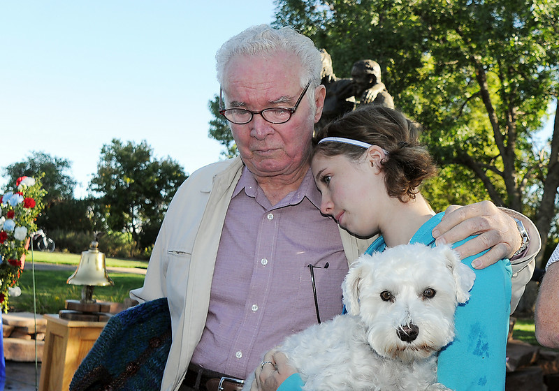 BE0919NINE08<br /> Juliet Faughnan, 13, who's father, Chris Faughnan, died in the north tower of the World Trade Center, while holding her dog Maverick, is comforted by her grandfather Tom Faughnan during the ceremony at the 9/11 Memorial on Saturday.<br /> <br /> September 11, 2010<br /> staff photo/David R. Jennings