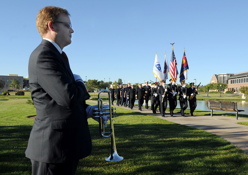 BE0919NINE05<br /> Bugler David Burkhardt stands at attention as the combine North Metro Fire and Broomfield Police Honor Guard marches to the 9/11 Memorial during the 9/11 ceremony on Saturday.<br /> <br /> September 11, 2010<br /> staff photo/David R. Jennings
