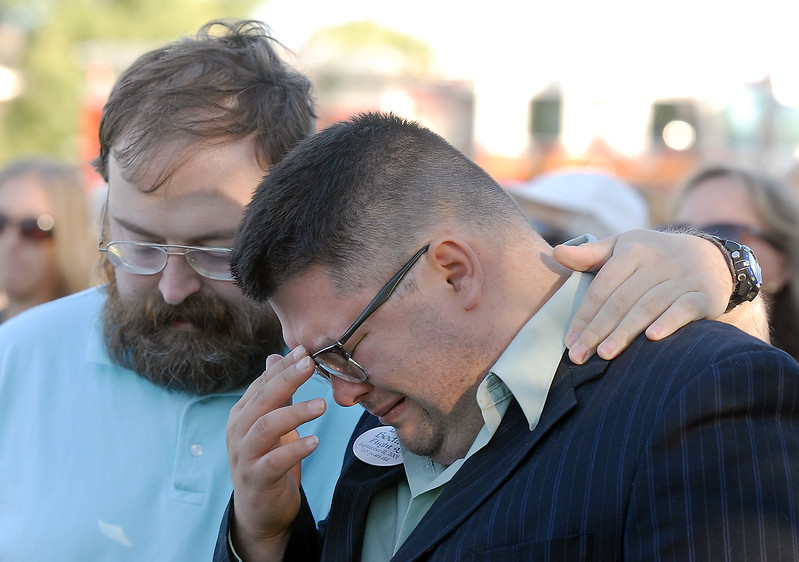 BE0919NINE07<br /> Joshua Miller cries in memory of his friend Deora Bodley, who died on Flight 93, is comforted by his friend David Henderson during the ceremony at the 9/11 Memorial on Saturday.<br /> <br /> September 11, 2010<br /> staff photo/David R. Jennings
