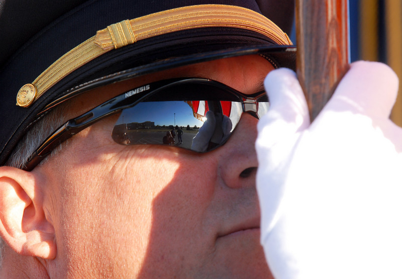 BE0919NINE11<br /> Broomfield Police Sgt. Rick Kempsell has the US flag reflected in his glasses during the ceremony at the 9/11 Memorial on Saturday.<br /> <br /> September 11, 2010<br /> staff photo/David R. Jennings