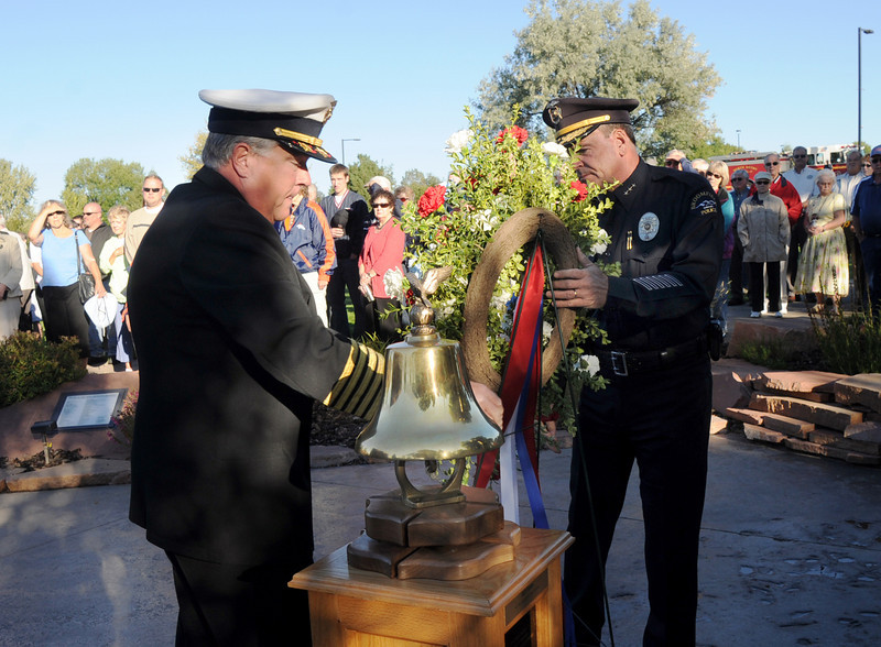 BE0919NINE38<br /> North Metro Fire Chief Joe Bruce, left, and Broomfield Police Chief Tom Deland place a wreath during the ceremony at the 9/11 Memorial on Saturday.<br /> <br /> September 11, 2010<br /> staff photo/David R. Jennings