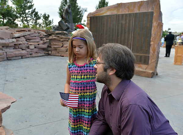 Joshua Gruber talks to his daughter Maddlynn, 7, after the 9/11 ceremony at the 9/11 Memorial at Community Park on Tuesday.<br /> September 11, 2012<br /> staff photo/ David R. Jennings