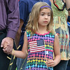 Maddlynn Gruber, 7, holds her father's hand during the 9/11 ceremony at the 9/11 Memorial at Community Park on Tuesday.<br /> September 11, 2012<br /> staff photo/ David R. Jennings