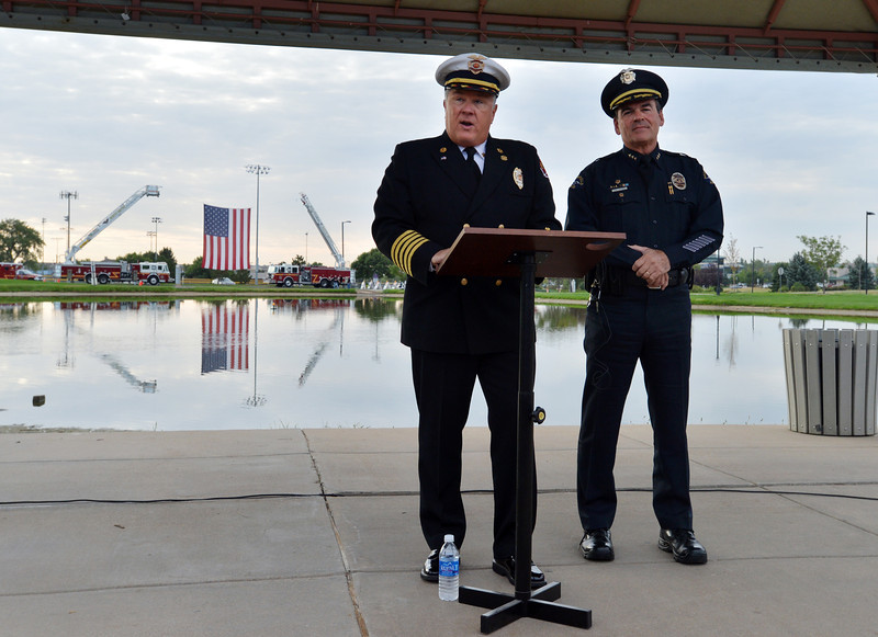 Cheif Joe Bruce, left, North Metro Fire Rescue District and Tom Deland , Broomfield Police Chief address the crowd during the 9/11 ceremony at the 9/11 Memorial in Community Park on Tuesday.<br /> September 11, 2012<br /> staff photo/ David R. Jennings