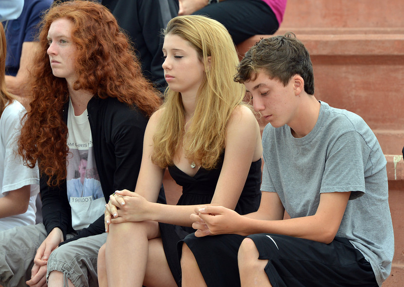 Juliet Faghnan, 15, center, and her brother Liam, 13, with their cousin Brigid Sleevi, 16, listen during the 9/11 ceremony at the 9/11 Memorial at Community Park on Tuesday.  The Faughana's lsot their father Chris in the 9/11 attacks in New York City.<br /> September 11, 2012<br /> staff photo/ David R. Jennings