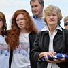 Joan Faughnan, with her family, holds the flag presented in honor of her Chris Faughnan, who died in the Twin Towers attack 11 years ago, during the 9/11 ceremony at the 9/11 Memorial at Community Park on Tuesday.<br /> September 11, 2012<br /> staff photo/ David R. Jennings
