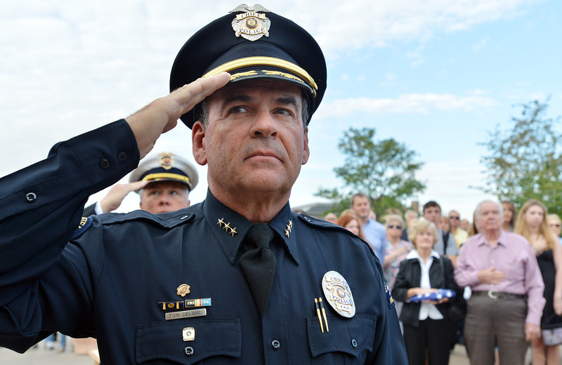 Broomfield Police Chief Tom Deland salutes during the 9/11 ceremony at the 9/11 Memorial at Community Park on Tuesday.<br /> September 11, 2012<br /> staff photo/ David R. Jennings