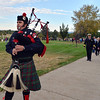 Perry Otero with Thornton Fire and the Colorado Emerald Society plays the bagpipes while marching to the during the 9/11 Memorial at Community Park on Tuesday.<br /> September 11, 2012<br /> staff photo/ David R. Jennings