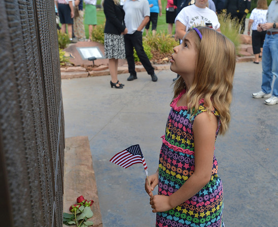 Maddlynn Gruber, 7, looks at the names on the New York portion of the 9/11 Memorial after the  at Community Park on Tuesday.<br /> September 11, 2012<br /> staff photo/ David R. Jennings