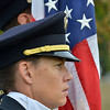 Broomfield Police Honor Guard member Crissy McCain during the 9/11 ceremony at the 9/11 Memorial at Community Park on Tuesday.<br /> September 11, 2012<br /> staff photo/ David R. Jennings