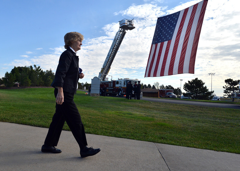 Joan Faughnan walks back to her car after the 9/11 ceremony at the 9/11 Memorial at Community Park on Tuesday.<br /> September 11, 2012<br /> staff photo/ David R. Jennings