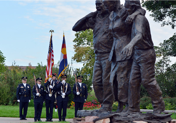 The Broomfield Police Honor Guard at attention during the 9/11 ceremony at the 9/11 Memorial at Community Park on Tuesday.<br /> September 11, 2012<br /> staff photo/ David R. Jennings