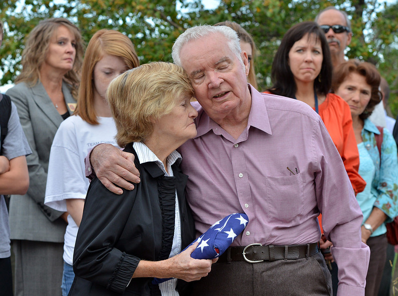 Joan and Tom Faughnan the parents of Chris Faughnan who died in the 9/11 attacks in New York City, comfort each other  during the 9/11 ceremony at the 9/11 Memorial in Community Park on Tuesday.<br /> September 11, 2012<br /> staff photo/ David R. Jennings