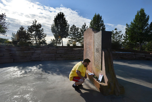 Joshua Miller reads a card at the Pennsylvania Flight 93 section of the 9/11Memorial after the ceremony at the 9/11 Memorial at Community Park on Tuesday.  MIller lost a friend Deora Bodley on Flight 93.<br /> September 11, 2012<br /> staff photo/ David R. Jennings