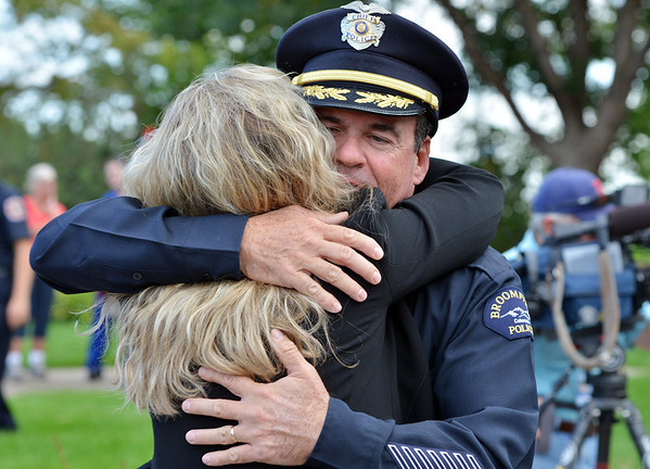 Broomfield Police Chief Tom Deland is hugged after the 9/11 ceremony at the 9/11 Memorial at Community Park on Tuesday.<br /> September 11, 2012<br /> staff photo/ David R. Jennings