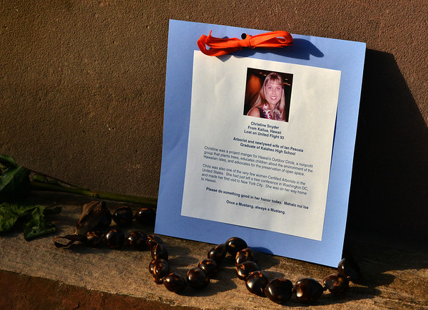 A card placed on the memorial honoring Christine Snyder who died on Flight 93 at the 9/11 Memorial at Community Park on Tuesday.<br /> September 11, 2012<br /> staff photo/ David R. Jennings