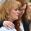 Ellen Sleevi, left, and her daughter Brigid, 16, comfort each other  during the 9/11 ceremony at the 9/11 Memorial at Community Park on Tuesday. Sleevi is the sister of Chris Faughnan who died in the 9/11 attacks.<br /> September 11, 2012<br /> staff photo/ David R. Jennings