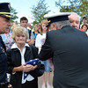 North Metro Fire Cheif Joe Bruce, right and Broomfield Police Cheif Tom Deland, left, honor Tom and Joan Faughnan for their son Chris, who died in the 9/11 attacks, during the 9/11 ceremony at the 9/11 Memorial at Community Park on Tuesday.<br /> September 11, 2012<br /> staff photo/ David R. Jennings