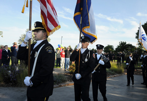 The combined honor guard with Jon Pierotti, left, Broomfield Police, Lt. Don Wiercinski, North Metro Fire and paramedic Jeff Burke, North Metro Fire, march after the ceremony at the 9/11 Memorial in Community Park in Broomfield on Friday morning.<br /> <br /> Sept. 11, 2009<br /> Staff photo/David R. Jennings