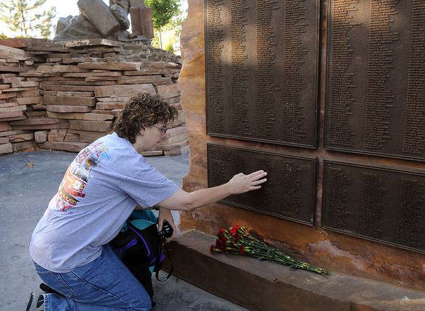 Ann Barry looks for the name of a New York firefighter, who died in the World Trade Center attacks, at the 9/11 Memorial in Community Park in Broomfield on Friday morning. Barry befriended the firefighter's sister.<br /> <br /> Sept. 11, 2009<br /> Staff photo/David R. Jennings