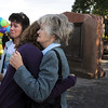 Siena Faughnan, 15, left, her grandmother Joan Faughnan, and aunt Maureen Stines comfort each other at the 9/11 Memorial on Friday as they remember Chris Faughnan who died in the World Trade Center attacks.  Chris was Siena's father. The New York part of the memorial is behind them.<br /> <br /> Sept. 11, 2009<br /> Staff photo/David R. Jennings