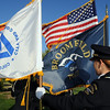 Carol Nelson-Lucero, Broomfield Police, organizes the flags before the 9/11 Memorial in Community Park in Broomfield on Friday morning.<br /> <br /> Sept. 11, 2009<br /> Staff photo/David R. Jennings