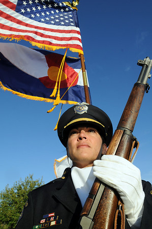 Angelia Scanga, Broomfield Police, leads the combined police fire honor guard as they march to the 9/11 Memorial for the ceremony on Friday.<br /> Sept. 11, 2009<br /> Staff photo/David R. Jennings