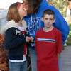 """Sonya Acker, center, kisses her daughter Samantha, 11, with her son Austyn, 9, after singing """"America the Beautiful"""" to themselves at the 9/11 Memorial in Community Park in Broomfield on Friday morning.<br /> <br /> Sept. 11, 2009<br /> Staff photo/David R. Jennings"""