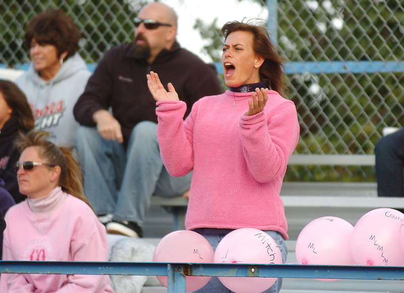 Michelle Lucero cheers on her son's team the Buckeye during Saturday's Broomfield Youth Football playoff game at Elizabeth Kennedy Stadium which was dedicated to Lucero, a breast cancer patient.<br /> October 9, 2010<br /> staff photo/David R. Jennings
