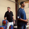 Denver Nuggets ambassadors Mark Randall, left, and Ervin Johnson wait to sign more autographs during A Precious Child Open House on Saturday.<br /> May 14, 2010<br /> Staff photo/ David R. Jennings
