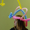 Amber Bryan, 20, waits to greet visitors wearing a balloon hat during A Precious Child open house on Saturday.<br /> May 14, 2010<br /> Staff photo/ David R. Jennings