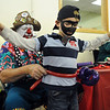 Josh Hertzenberg, 6, has a balloon sword and belt strapped on by Willy the Clown during A Precious Child open house on Saturday.<br /> May 14, 2010<br /> Staff photo/ David R. Jennings