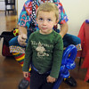 Kyan Dunn, 2 1/2, shows off his balloon sword made by Willy the Clown during A Precious Child open house on Saturday.<br /> May 14, 2010<br /> Staff photo/ David R. Jennings
