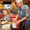 "BE0823MIM03<br /> Leonard Muniz collects tips for the wait staff who donated their time for the ""A Summer's Night at Mimi's"" fundraiser for the Broomfield Senior Center at Mimi's Cafe at FlatIron on Wednesday.<br /> <br /> August 19, 2009<br /> staff photo/David R. Jennings"