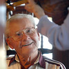 "Harry Counsil listens to the serenade played by violinist Lucille Weed during the ""A Summer's Night at Mimi's"" fundraiser for the Broomfield Senior Center at Mimi's Cafe at FlatIron on Wednesday.<br /> <br /> August 19, 2009<br /> staff photo/David R. Jennings"