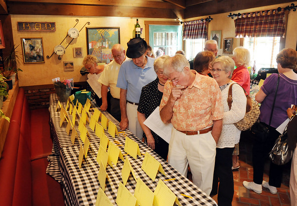 "Participants look at items to bid on at the silent auction druing the ""A Summer's Night at Mimi's"" fundraiser for the Broomfield Senior Center at Mimi's Cafe at FlatIron on Wednesday.<br /> <br /> August 19, 2009<br /> staff photo/David R. Jennings"