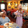 "Lucille Weed, right, serenades Vivian Brockman-Swenson during the ""A Summer's Night at Mimi's"" fundraiser for the Broomfield Senior Center at Mimi's Cafe at FlatIron on Wednesday.<br /> <br /> August 19, 2009<br /> staff photo/David R. Jennings"