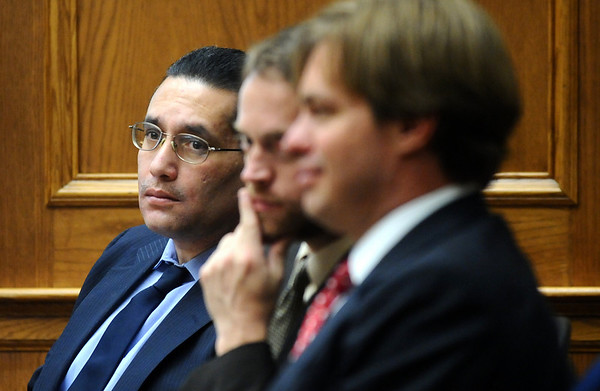 ABEYTA14.JPG ABEYTA14<br /> Defendant Joseph Abeyta, left, listens to testimony Thursday during his trial. With him are his attorneys, David Jones, center, and Jason Savela. Abeyta is accused of murdering his friend, William Andrews, in north Boulder in January 2009.<br /> <br /> Photo by Marty Caivano/Camera/Oct. 16, 2009/