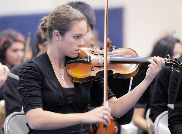 Concert mistress Michelle Phillips, 18, Mtn. Range, plays a solo during the performance of the the High School Symphonic Orchestra for the Adams 12 Five Stars Schools Orchestra Festival at Legacy High School on Saturday.<br /> For more photos please see broomfieldenterprise.com.<br /> December 3, 2011<br /> staff photo/ David R. Jennings