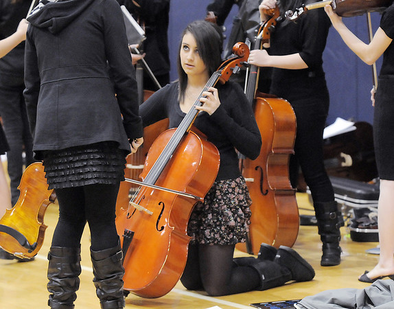 Rocky Top Middle School cellist Tatum Krausert, 13, warms up before  performing in the Adams 12 Five Stars Schools Orchestra Festival at Legacy High School on Saturday.<br /> For more photos please see broomfieldenterprise.com.<br /> December 3, 2011<br /> staff photo/ David R. Jennings