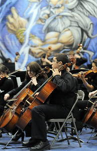 The High School Symphonic Orchestra cello section performs during the Adams 12 Five Stars Schools Orchestra Festival at Legacy High School on Saturday. For more photos please see broomfieldenterprise.com. December 3, 2011 staff photo/ David R. Jennings