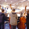 The double bass section of the High School Concert Orchestra perfom during the Adams 12 Five Stars Schools Orchestra Festival at Legacy High School on Saturday.<br /> For more photos please see broomfieldenterprise.com.<br /> December 3, 2011<br /> staff photo/ David R. Jennings