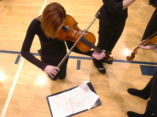 Meryl Aune, 15, Legacy, plays her violin while warming up for the Adams 12 Five Stars Schools Orchestra Festival at Legacy High School on Saturday.<br /> For more photos please see broomfieldenterprise.com.<br /> December 3, 2011<br /> staff photo/ David R. Jennings