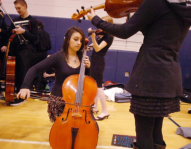 Rocky Top Middle School cellist Tatum Krausert, 13, warms up before  performing in the Adams 12 Five Stars Schools Orchestra Festival at Legacy High School on Saturday. For more photos please see broomfieldenterprise.com. December 3, 2011 staff photo/ David R. Jennings