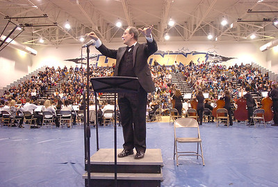 Steven Burchard, conducts the combined orchestras of 510 players in the Can-Can for the Adams 12 Five Stars Schools Orchestra Festival at Legacy High School on Saturday. For more photos please see broomfieldenterprise.com. December 3, 2011 staff photo/ David R. Jennings